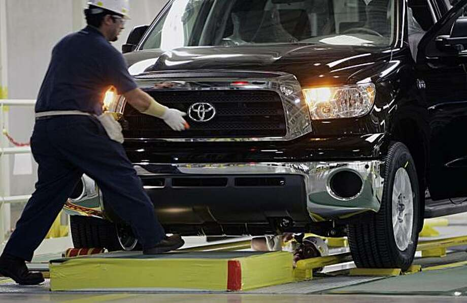 FILE - In this Nov. 15, 2006 file photo, a Toyota Tundra is inspected during the final stages of assembly at the Toyota Manufacturing Texas, Inc. in  San Antonio. Toyota said Tuesday, Feb. 16, 2010, it plans to idle production temporarily at assembly plants in Texas and Kentucky while it grapples with massive recalls in the United States. Photo: Eric Gay, AP