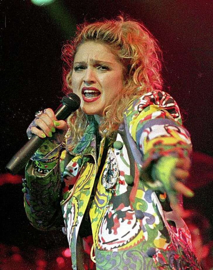In this April 10, 1985 file photo, pop star Madonna performs during the opening of The Virgin Tour in Seattle.   (AP Photo/Barry Sweet, file) Photo: Barry Sweet, AP