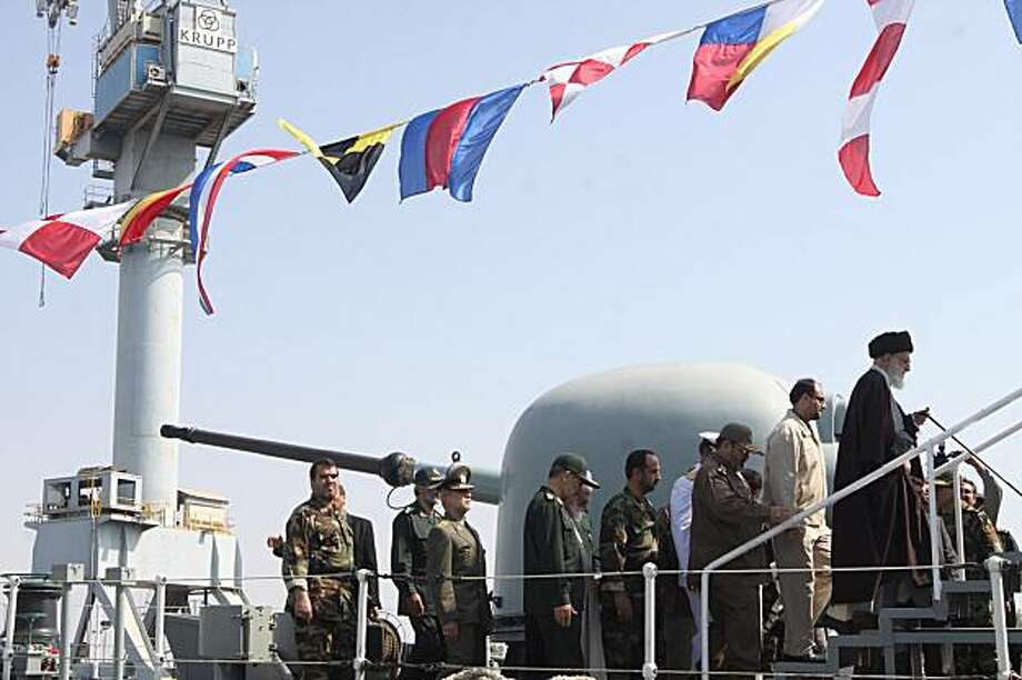 This photo released by an official website of the Iranian supreme leader's office shows Iranian supreme leader Ayatollah Ali Khamenei, right, steps onto the Jamaran guided-missile destroyer, as he is accompanied by military commanders, in the Persian Gulf, Iran, Friday, Feb. 19, 2010. Iranian state TV is reporting that the country has launched its first domestically built destroyer, calling it a major technological leap for its naval industries. Photo: Office Of The Supreme Leader, AP