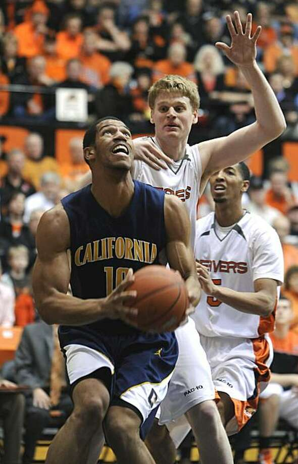 California's Jamal Boykin (10) looks to shoot against Oregon State's Roeland Schaftenaar, middle, during the first half of an NCAA college basketball game in Corvallis, Ore., Thursday Feb. 18, 2010. Photo: Greg Wahl-Stephens, AP
