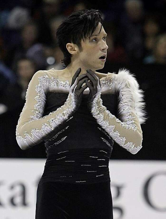 FILE - In this Jan. 17, 2010, file photo, Johnny Weir competes during the men's free skate at the U.S. Figure Skating Championships in Spokane, Wash., Sunday, Jan. 17, 2010. Weir finished third in the competition. Friends of Animals has posted an open letter to Weir criticizing him for having fox fur on one of his costumes and asking him to stop wearing fur. Photo: Elaine Thompson, AP