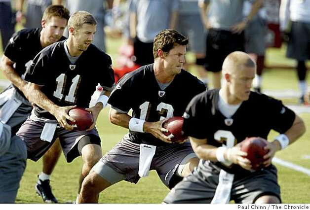 From left, quarterbacks J.T. O'Sullivan, Alex Smith, Shaun Hill, and Kyle Wright practice at the first day of training camp for the San Francisco 49ers in Santa Clara, Calif., on Friday, July 25, 2008. Photo: Paul Chinn, The Chronicle