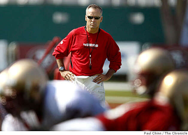 Head coach Mike Nolan watches the offensive team practice at training camp for the San Francisco 49ers in Santa Clara, Calif., on Friday, July 25, 2008.Photo by Paul Chinn / The Chronicle Photo: Paul Chinn, The Chronicle