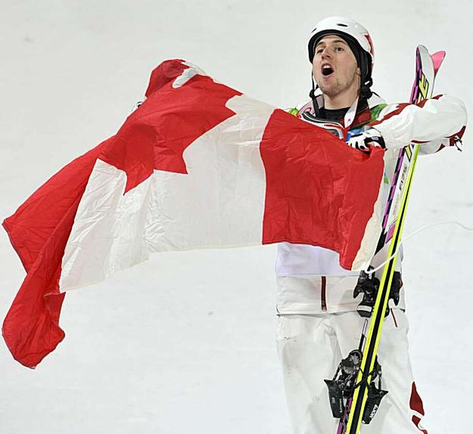 Alexandre Bilodeau of Canada celebrates becoming Olympic champion in moguls at the Vancouver 2010 Olympics in Vancouver, British Columbia, Sunday, Feb. 14, 2010. Photo: Bela Szandelszky, AP