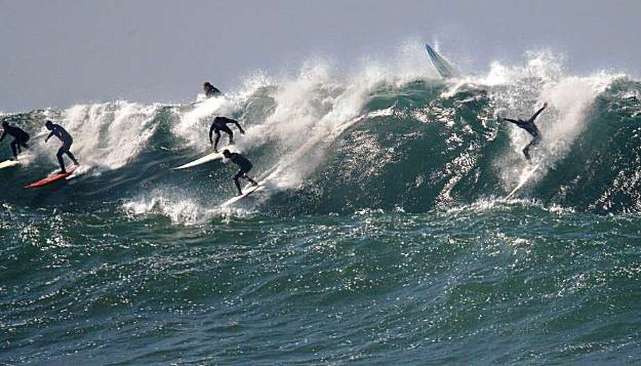 The waves are getting bigger and surfers are getting plenty as dozens where seen riding the giants at Mavericks off Pillar Point in San Mateo County Calif., on October 22, 2009. Photo: Frederic Larson, The Chronicle