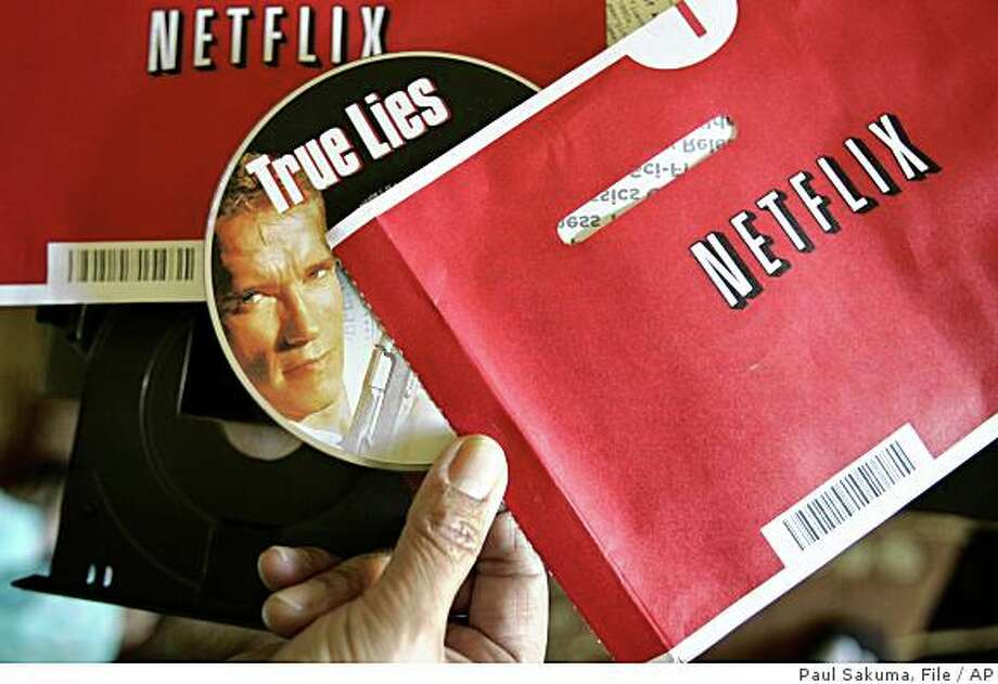 "**FILE** In this Oct. 22, 2007 file photo, a Netflix customer prepares to watch the movie ""True Lies,"" at her home in Palo Alto, Calif., Oct. 22, 2007. Netflix Inc. said Thursday, Aug. 14, 2008, that major technical problems over the past three days have severely limited the number of DVDs it could send out. (AP Photo/Paul Sakuma, file) Photo: Paul Sakuma, File, AP"