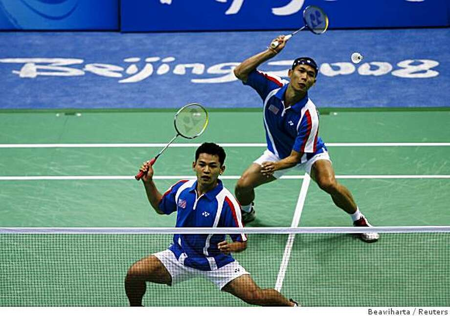 Howard Bach (L) and Bob Malaythong of the U.S. compete in their men's doubles quarterfinals badminton match against China at the Beijing 2008 Olympic Games August 13, 2008. Photo: Beawiharta, Reuters