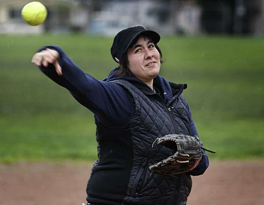 Eva Silverman prepares for the upcoming softball season at San Pablo Park in Berkeley, Calif., on Thursday, Feb. 4, 2010. Silverman, who plays third base for the Bakers Dozen team, still uses her trusty 15-year-old Rawlings softball glove. Photo: Paul Chinn, The Chronicle