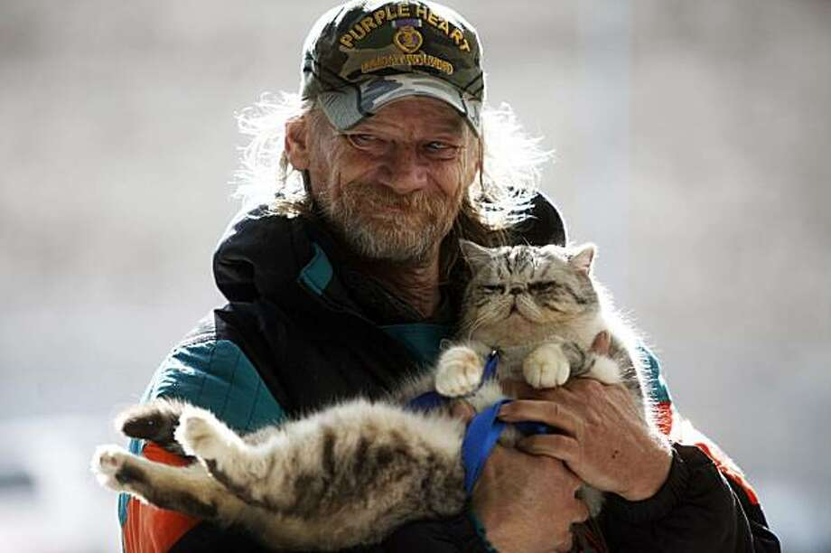 Daniel Harlan is reunited with Samantha on Minna Street in San Francisco on Tuesday. Photo: Mike Kepka, The Chronicle