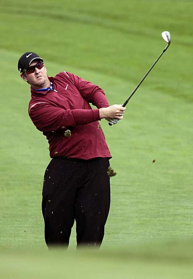 David Duval hits his approach shot onto the 9th green at Spyglass Hill Golf course during the opening day of the AT&T Pro-Am Thursday February 11, 2010. Duval shot a 67, to finish five strokes under par. Photo: Lance Iversen, The Chronicle
