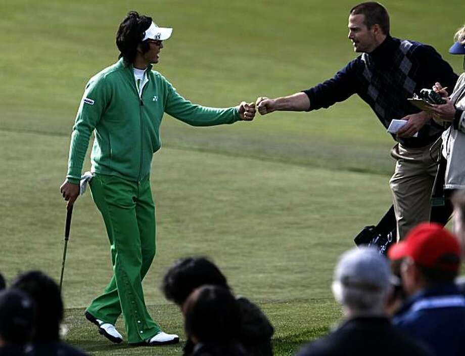 Ryo Ishikawa, (left) congratulates Chris O'Donnell who just sank a long putt on the 6th hole of the Monterey Peninsula Course during round 1 of the AT&T National Pro-Am golf tournament on Thursday February 11, 2010, in Pebble Beach, Calif. Photo: Michael Macor, The Chronicle