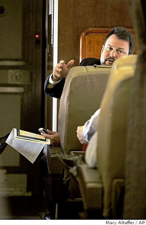 Randy Scheunemann, top foreign policy adviser for Republican presidential candidate, Sen. John McCain, R-Ariz., facing camera, holds a map of Georgia, while speaking to the senator, Wednesday, Aug. 13, 2008, on board the Straight Talk Air campaign airplane while waiting on the runway to take off in Newark, N.J.  (AP Photo/Mary Altaffer) Photo: Mary Altaffer, AP