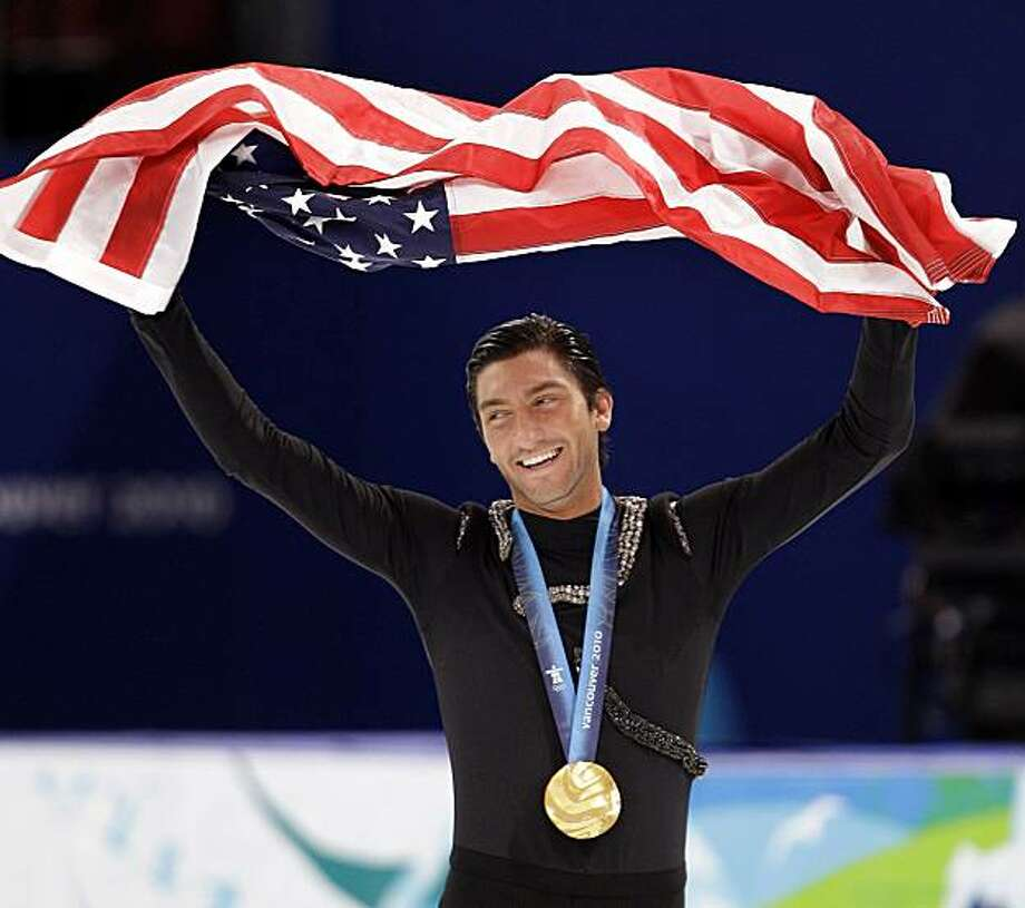 USA's Evan Lysacek skates during the victory ceremony after winning the gold medal in the men's free program figure skating competition at the Vancouver 2010 Olympics in Vancouver, British Columbia, Thursday, Feb. 18, 2010. Photo: David J. Phillip, AP