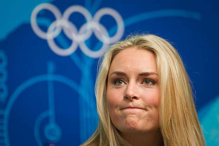 US alpine skier Lindsey Vonn reacts to a question during a press conference in advance of the 2010 Winter Olympic Games on Wednesday, Feb. 10, 2010, in Vancouver.  Vonn revealed  that she sustained a shin injury in training that puts her participation in the games in question. ( Smiley N. Pool / Houston Chronicle ) Photo: Smiley N. Pool, Houston Chronicle