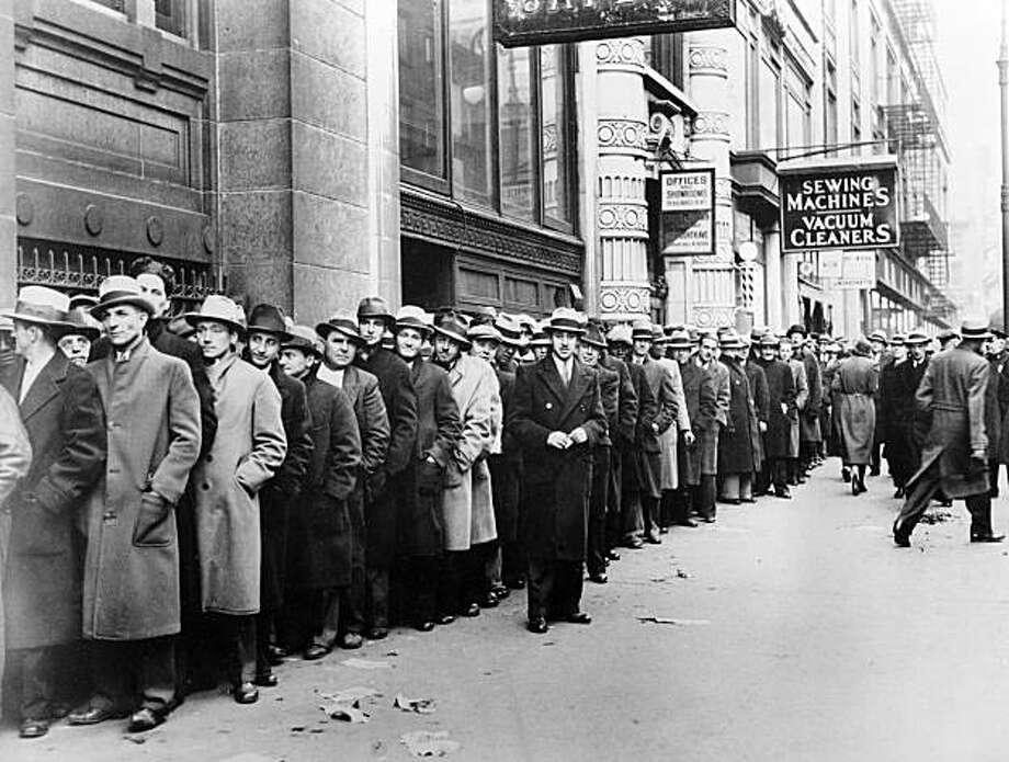 ** FILE ** In this Nov. 24, 1933 file photo, some of nearly 5,000 unemployed people wait outside the State Labor Bureau which houses the State Temporary Employment Relief administration in New York. The epic hardship of the 1930s is the best-known depression in American history, but it doesn't necessarily take that kind of nightmare to trigger the D-word.  (AP File Photo) Photo: AP