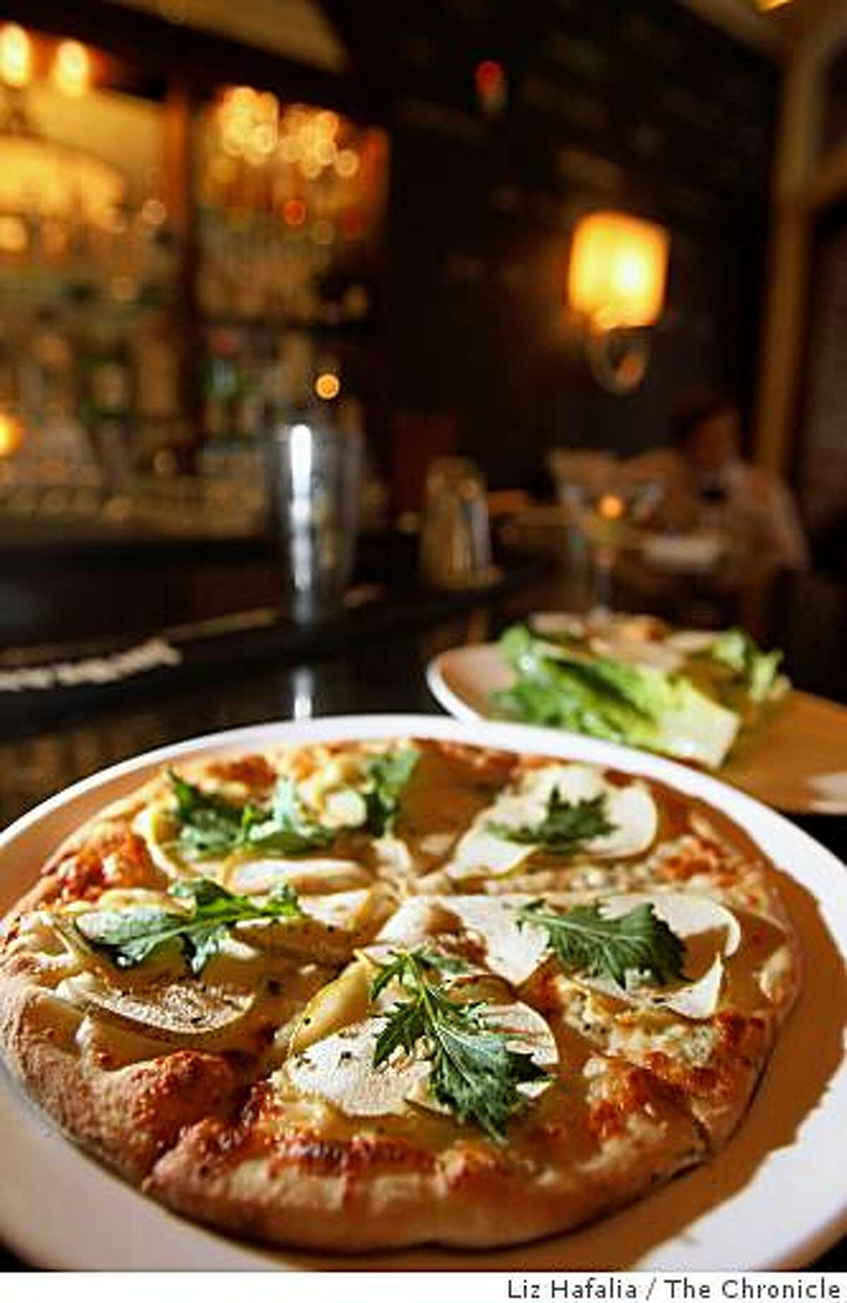 Pizza and caesar salad on the bar of Enrico's, a well-known North Beach bar and restaurant in San Francisco, Calif., on Monday, August 4, 2008.Photo by Liz Hafalia/The Chronicle