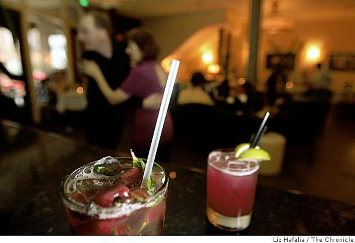 A Bing Cherry Mojito (left) and a Cactus Pear Margarita (right) at Enrico's, a well-known North Beach bar and restaurant in San Francisco, Calif., on Monday, August 4, 2008.