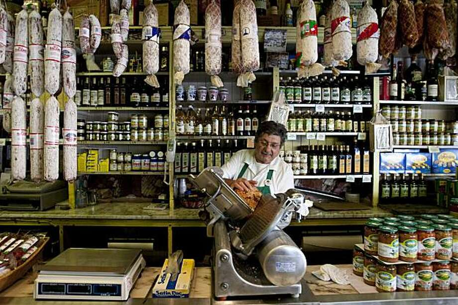 Franco Crivello works the slicer at Molinari Delicatessen on Columbus Ave. in San Francisco, Calif., on Thursday, February 11, 2010. Photo: Laura Morton, Special To The Chronicle