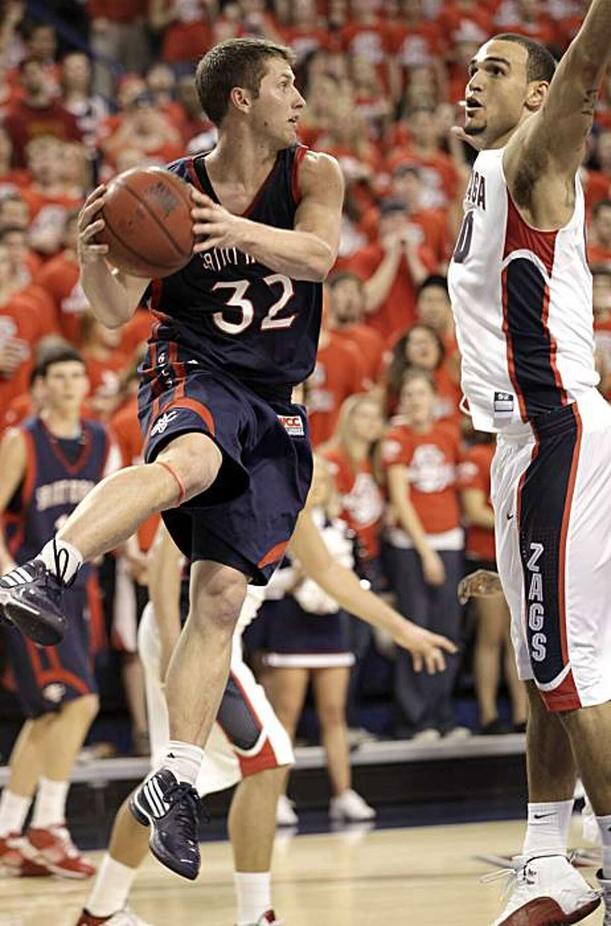 St. Mary's Mickey McConnell(32) looks to pass against Gonzaga's Robert Sacre during the second half of their NCAA college basketball game at the McCarthey Athletic Center in Spokane, Wash. Thursday, Feb.11, 2010.
