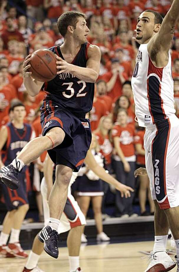 St. Mary's Mickey McConnell(32)  looks to pass against Gonzaga's Robert Sacre during the second half of their NCAA college basketball game at the McCarthey Athletic Center in Spokane, Wash. Thursday, Feb.11, 2010. Photo: Rajah Bose, AP