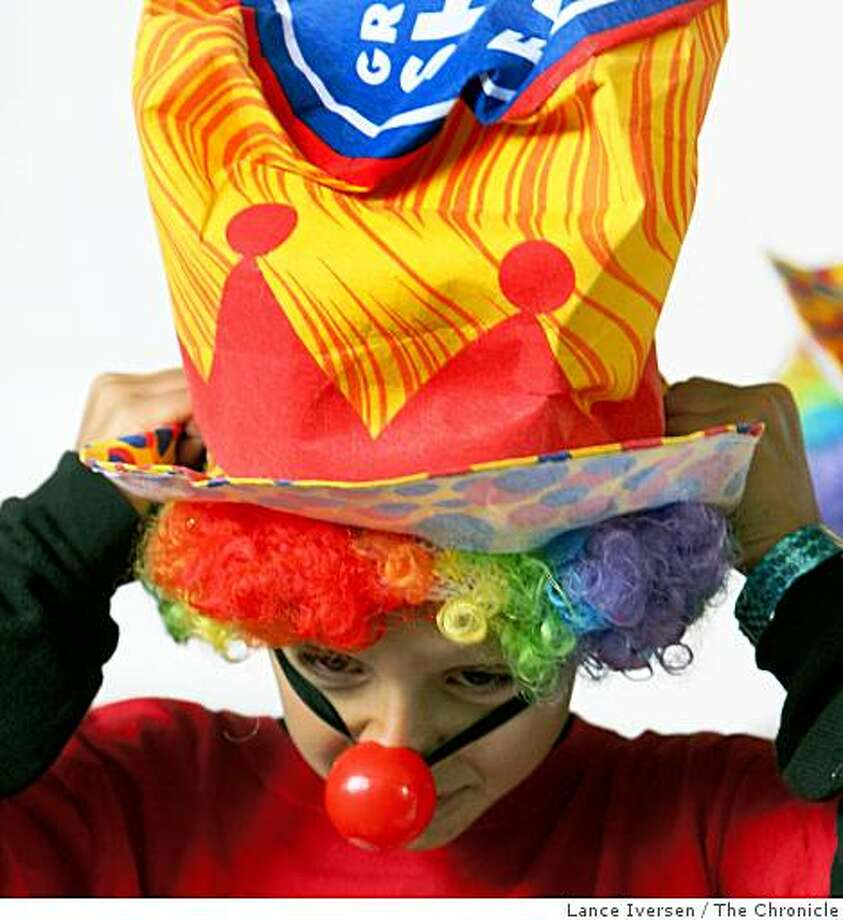 Emiliano Profumo age 9, from Millbrae puts his costume on as he joined 200 other clowns including the clowns from Ringling Bros. and Barnum & Bailey Circus as they set a new world record stuffing a BART train car with 201 volunteer clowns at the Millbrae Station. Photo: Lance Iversen, The Chronicle