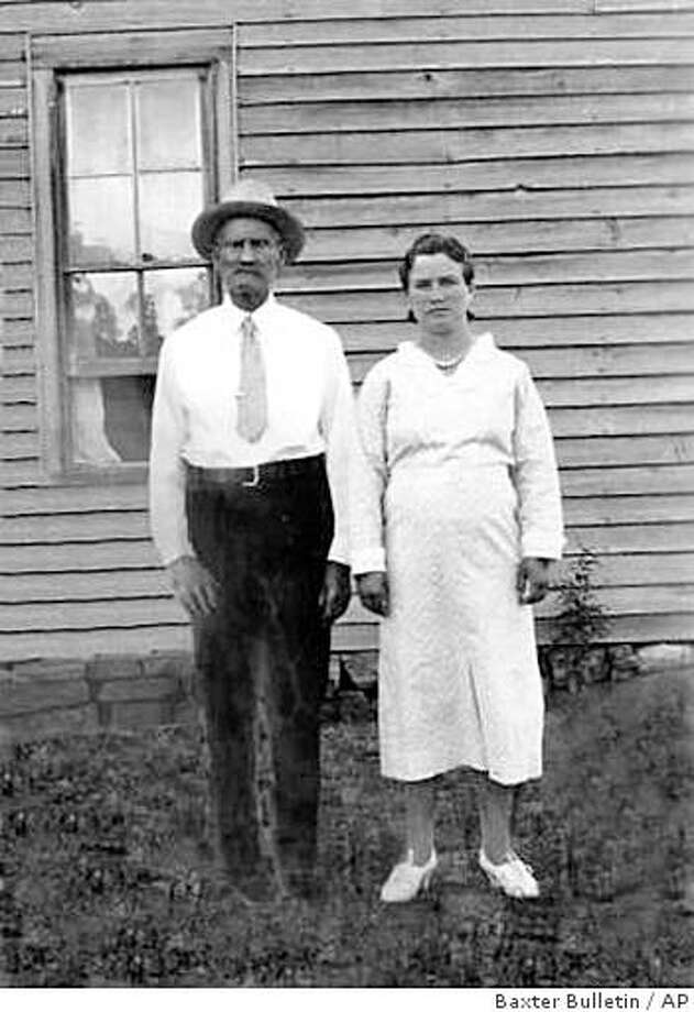 **FILE**In this 1936 photo, Maudie Cantrell, right, and her husband William Cantrell, a Confederate Civil War Veteran, pose in Advance, Ark.  She  married the Confederate army veteran 67 years her senior in January 1934. He died in 1937. Maudie White Hopkins, her name after three more  marriages,  died Sunday, Aug. 17, 2008, at age 93. (AP Photo/Baxter Bulletin) Photo: Baxter Bulletin, AP