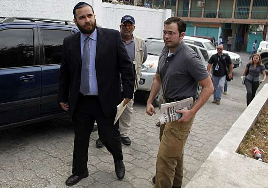 FILE -  In this Feb. 8, 2010 file photo, Jorge Puello, left, a Dominican legal advisor who was hired by the relatives of the 10 Americans that were arrested while trying to bus children out of Haiti without proper documents or government permission, arrives to the court building in Port-au-Prince. Dominican officials said Friday that Puello has no license to practice law in his native country. Photo: Javier Galeano, AP