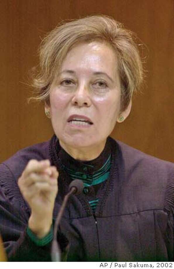 California Supreme Court Justice Joyce Kennard gestures in a courtroom in Fresno, Calif., Tuesday, Oct. 8, 2002. The court begins considering whether the governor has absolute power to overturn the Board of Prison Terms position to parole convicted murderers. (AP Photo/Paul Sakuma) ALSO RAN 8/6/2003 Justice Joyce Kennard writes of balancing the interests of the employers and employees. Theresa McGinnis waited two years before reporting the harassment. Theresa McGinnis waited two years before reporting the harassment. ProductName	Chronicle ProductName	Chronicle CAT Photo: PAUL SAKUMA