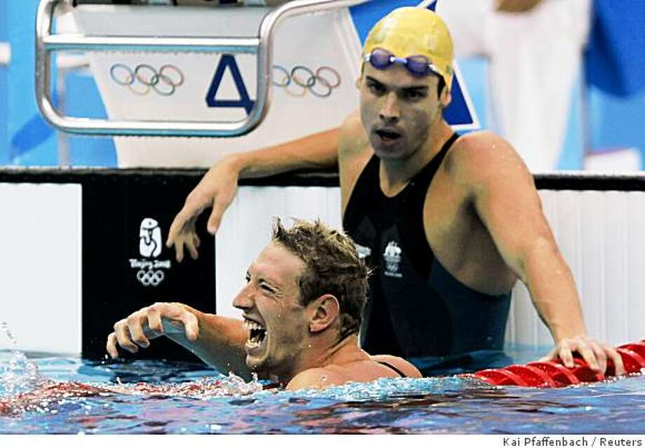 REFILE - QUALITY REPEATAlain Bernard (L) of France celebrates after beating Eamon Sullivan of Australia in the men's 100m freestyle swimming final at the National Aquatics Center during the Beijing 2008 Olympic Games, August 14, 2008.     REUTERS/Kai Pfaffenbach (CHINA) Photo: Kai Pfaffenbach, Reuters
