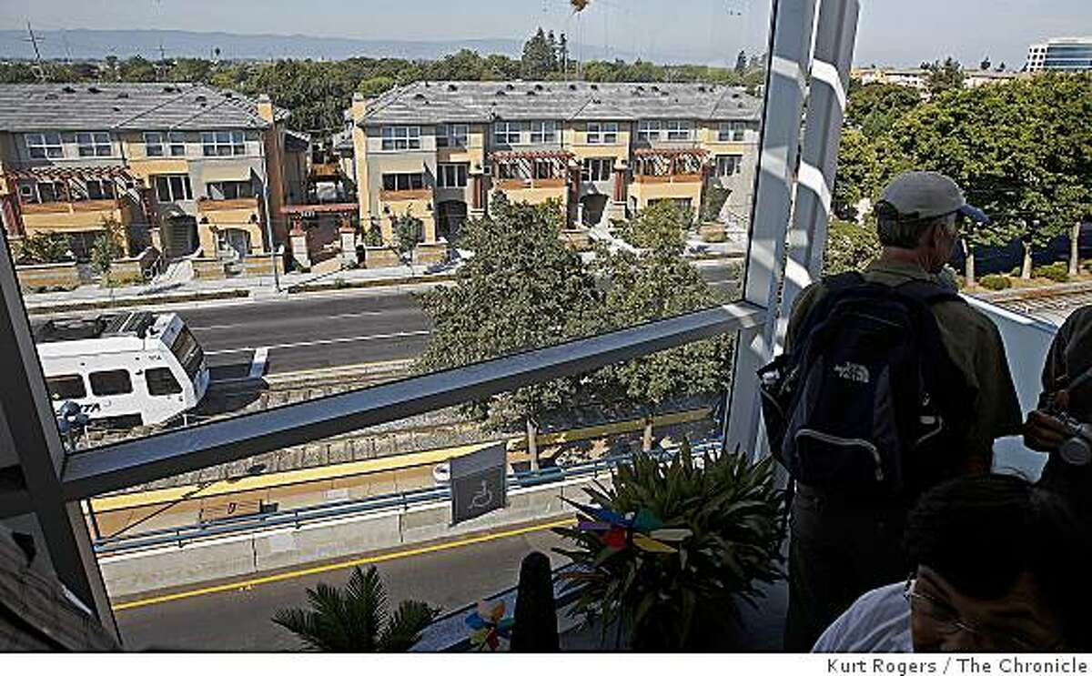 People on the redevelopment tour of San Jose stopped at the Gish Apartments for a tour of the housing. This is looking out from a fourth floor Apartment looking down on at the Gish VTA stop. on Saturday, Aug 16 2008 in San Jose , Calif