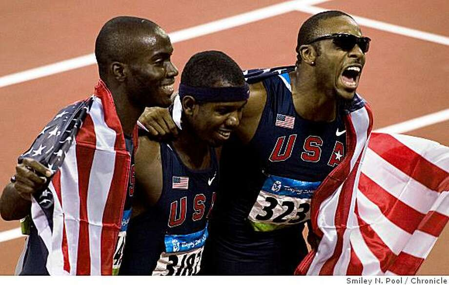 Kerron Clement, left, Bershawn Jackson and Angelo Taylor of the USA celebrate after sweeping the medals in the 400M hurdles final at the 2008 Summer Olympic Games, Monday, Aug. 18, 2008, in Beijing.  Taylor finished first, Clement second and Jackson third. Photo: Smiley N. Pool, Chronicle