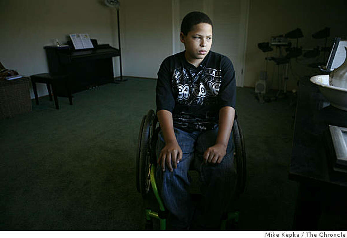 Christopher Rodriguez, 11, poses for a portrait his home on Thursday July 3, 2008 in Oakland, Calif. Six months ago Rodriguez was shot by a stray bullet that went through the window while he was taking piano lessons. Recently he auditioned his piano skills for the Oakland School of the Arts and was accepted.Photo by Mike Kepka / The Chronicle