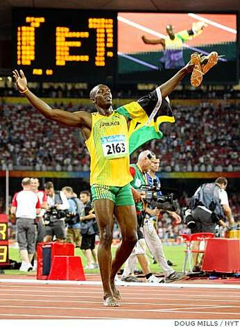 (NYT36) BEIJING -- Aug. 16, 2008 -- OLY-ATH-100M-BOLT-8 --  Jamaican sprinter Usain Bolt celebrates barefoot after winning the gold in the Men's track 100M final at National Stadium, at the 2008 Summer Olympics in Beijing, China, Saturday, Aug. 16, 2008. Bolt, the Jamaican sprinter who has crashed the international sprint scene this year, crushed the world record in the 100 meters in theatrical fashion for the gold. (Doug Mills/The New York Times) Photo: DOUG MILLS, NYT
