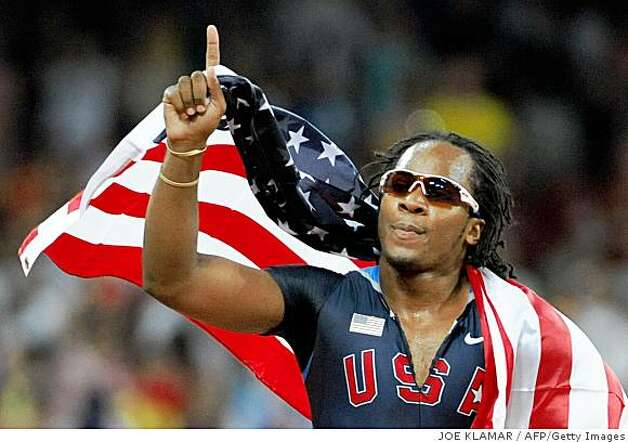 Walter Dix of the US celebrates afte placing third in the men's 100m final at the National stadium as part of the 2008 Beijing Olympic Games on August 16, 2008. Jamaica's Usain Bolt won ahead of Trinidad and Tobago's Richard Thompson and Walter Dix of the US.      AFP PHOTO / WILLIAM WEST (Photo credit should read JOE KLAMAR/AFP/Getty Images) Photo: JOE KLAMAR, AFP/Getty Images