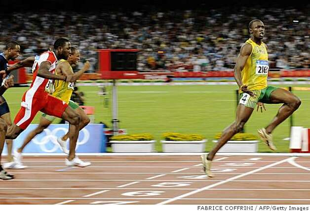 Jamaica's Usain Bolt (R) wins the men's 100m final at the National stadium as part of the 2008 Beijing Olympic Games on August 16, 2008.     AFP PHOTO / FABRICE COFFRINI (Photo credit should read FABRICE COFFRINI/AFP/Getty Images) Photo: FABRICE COFFRINI, AFP/Getty Images