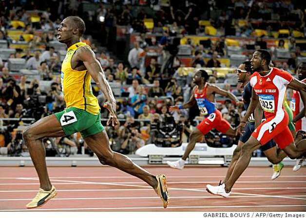 Jamaica's Usain Bolt (L) wins the men's 100m final at the National stadium as part of the 2008 Beijing Olympic Games on August 16, 2008.      AFP PHOTO / GABRIEL BOUYS (Photo credit should read GABRIEL BOUYS/AFP/Getty Images) Photo: GABRIEL BOUYS, AFP/Getty Images