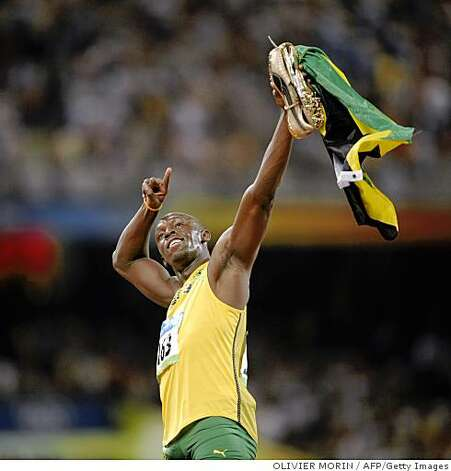 "Jamaica's Usain Bolt celebrates after winning the men's 100m final at the ""Bird's Nest"" National Stadium as part of the 2008 Beijing Olympic Games on August 16, 2008. Jamaica's Usain Bolt won the Olympic Games men's 100m gold medal in a new world record time of 9.69sec. Trinidad and Tobago's Richard Thompson (9.89sec) and Walter Dix of the US (9.91) took silver and bronze respectively.   AFP PHOTO / OLIVIER MORIN (Photo credit should read OLIVIER MORIN/AFP/Getty Images) Photo: OLIVIER MORIN, AFP/Getty Images"