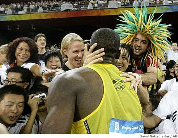 Jamaica's Usain Bolt is congratulated by fans after winning the gold in the men's 100-meter final during the athletics competitions in the National Stadium  at the Beijing 2008 Olympics in Beijing, Saturday, Aug. 16, 2008. (AP Photo/David Guttenfelder) Photo: David Guttenfelder, AP