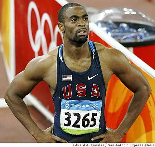 Tyson Gay looks at the scoreboard after failing to qualify for the men's 100m final during the second day of track and field at the 2008 Beijing Olympics Saturday Aug 16, 2008 in Beijing, China. Photo: Edward A. Ornelas, San Antonio Express-News