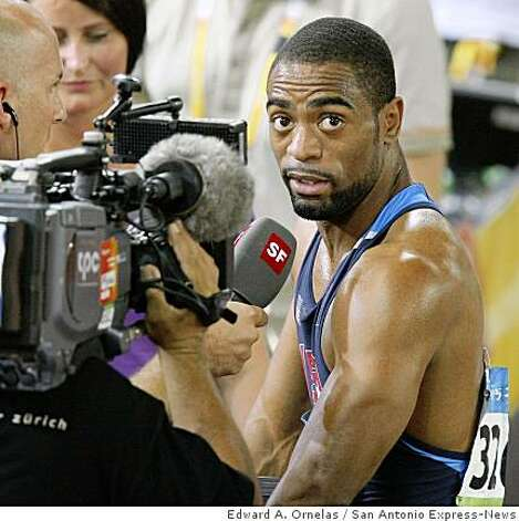 Tyson Gay answers questions from the media after failing to qualify for the men's 100m final during the second day of track and field at the 2008 Beijing Olympics Saturday Aug 16, 2008 in Beijing, China. Photo: Edward A. Ornelas, San Antonio Express-News