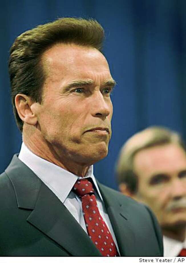 California Governor Arnold Schwarzenegger talks to reporters before signing an executive order eliminating 22,000 part-time and temporary positions and ordered that up to 200,000 state workers receive the federal minimum wage during a news conference at the Capitol in Sacramento, Calif., on Thursday, July 31, 2008.  (AP Photo/Steve Yeater) Photo: Steve Yeater, AP