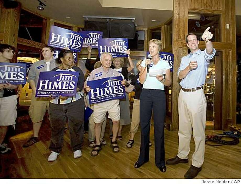 Mary Himes makes an introduction speech while celebrating next to her husband and democratic congressional candidate, Jim Himes, after his victory in the Democratic Primary in Norwalk, Ct. on Tuesday, Aug. 12, 2008.   (AP Photo/Connecticut Post, Jesse Neider)  ** MANDATORY CREDIT ** Photo: Jesse Neider, AP