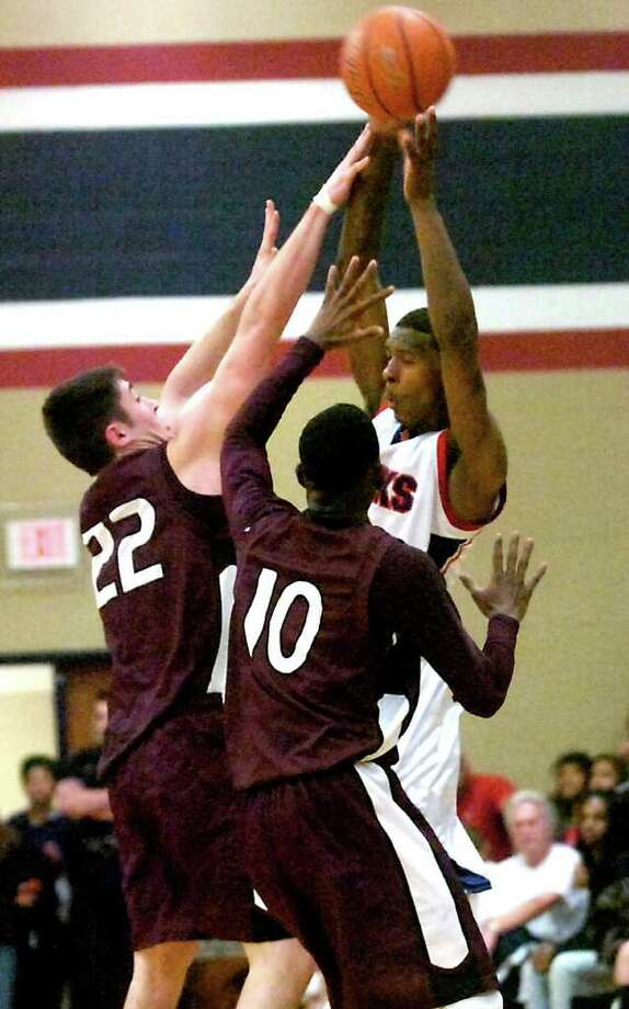 H-J's Shawn Prudhomme tries to pass over Silsbee's Jacob Dobbins and Chris Elam at Hardin-Jefferson High School in Sour Lake, Tuesday, January 31, 2012. Tammy McKinley/The Enterprise Photo: TAMMY MCKINLEY
