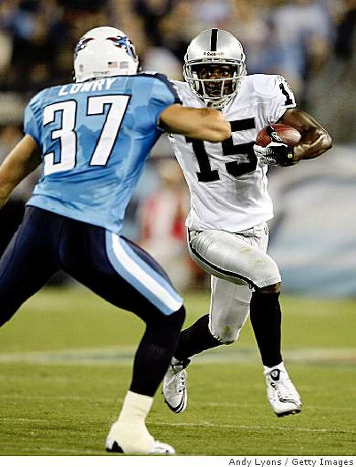 NASHVILLE, TN - AUGUST 15:  Johnnie Lee Higgins #15 of the Oakland Raiders runs with the ball against Calvin Lowry #37 of the Tennessee Titans during the NFL pre-season game at LP Field August 15, 2008 in Nashville, Tennessee.  (Photo by Andy Lyons/Getty Images) Photo: Getty Images