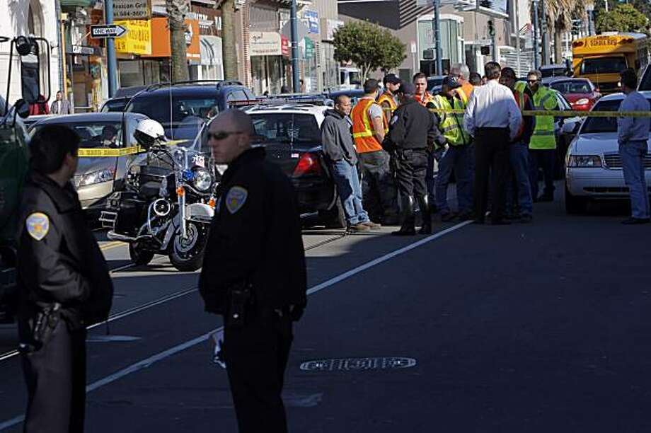 Police investigate a fatal pedestrian accident on Ocean Avenue in San Francisco on Tuesday. The pedestrian was struck and killed by a San Francisco Water Department truck. Photo: Carlos Avila Gonzalez, The Chronicle