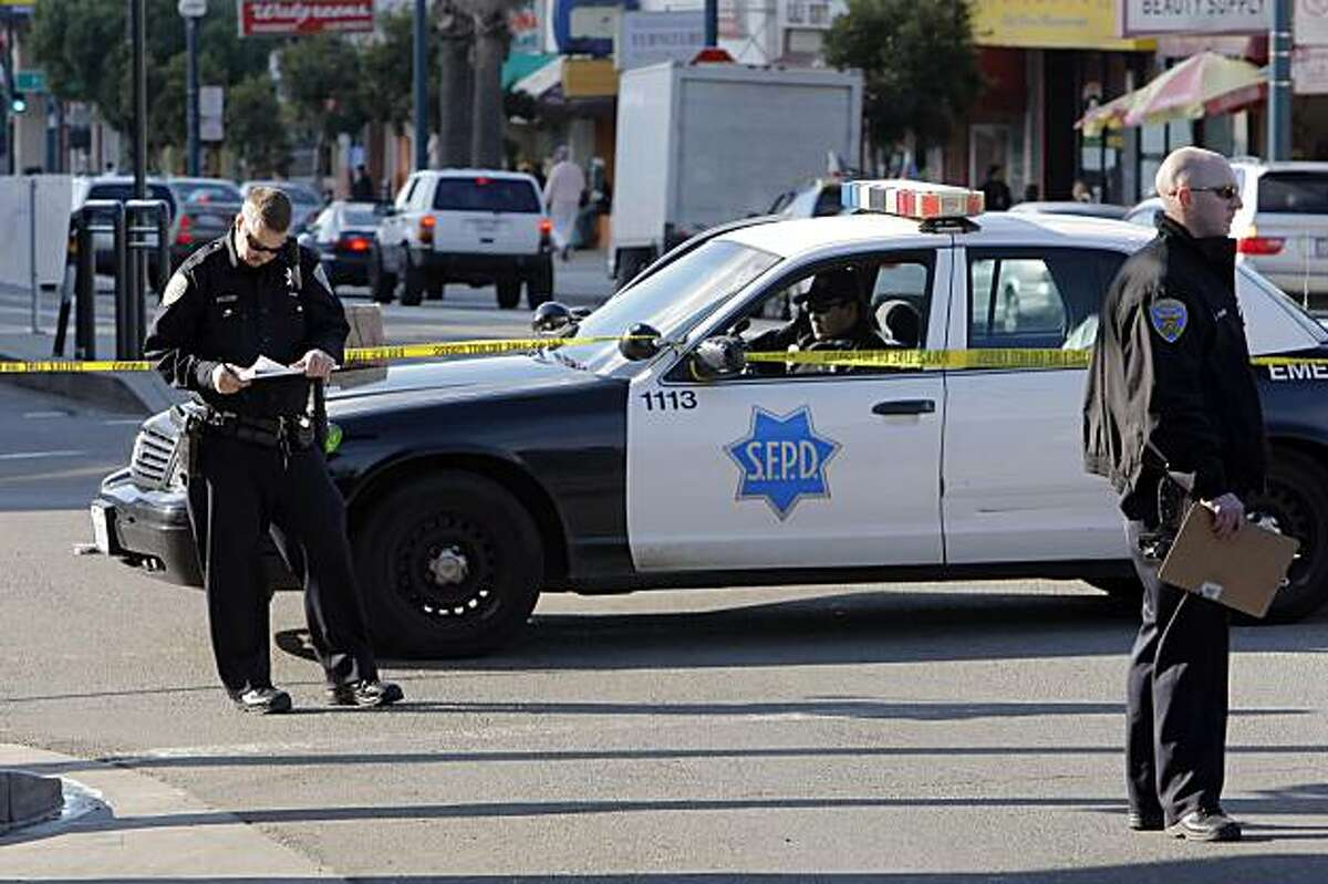 Police investigate a fatal pedestrian accident on Ocean Avenue in San Francisco on Tuesday. The pedestrian was struck and killed by a San Francisco Water Department truck.