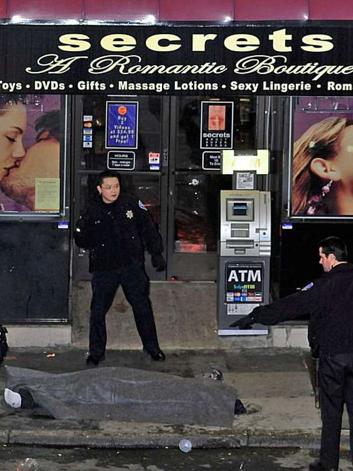 In this photo provided by Mark Grissom, police investigate the shooting scene in the early hours of Sunday morning Feb. 7, 2010 outside the Suede Nightclub and Lounge in San Francisco that left one person dead and four critically injured.  (AP Photo/Mark Grissom)  MANDATORY CREDIT, NO SALES Photo: Mark Grissom, AP