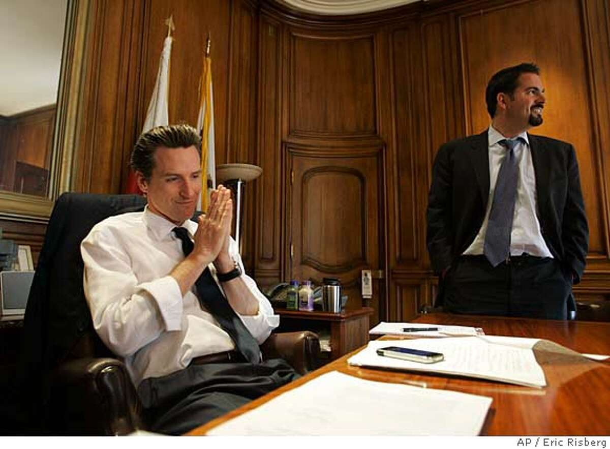 San Francisco Mayor Gavin Newsom and his Director of Communications, Nathan Ballard, right, reacts to the news that the California Supreme Court has overturned a ban on gay marriages, in his office in San Francisco, Thursday, May 15, 2008. The California Supreme Court overturned a voter-approved ban on gay marriage, paving the way for the state to become the second in the United States where gay and lesbian residents can marry. The justices released the 4-3 decision Thursday, saying that domestic partnerships are not a good enough substitute for marriage in an opinion written by Chief Justice Ron George. (AP Photo/Eric Riserg)