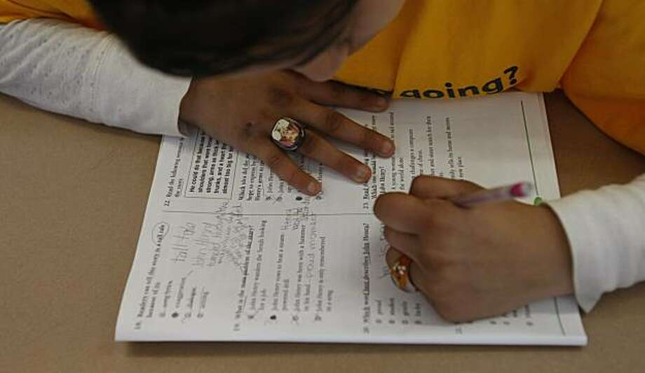 "A fifth-grade student in the class of Ms. deSilva at Monarch Academy practices for the STAR test on a day they call ""figure it out Friday.""  Monarch Academy, Friday  May 9, 2008, Oakland, Calif. Lacy Atkins / San Francisco Chronicle Photo: Lacy Atkins, The Chronicle"