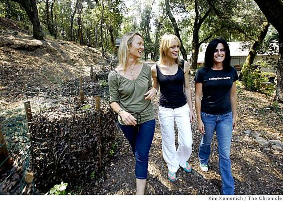 EcoMom Alliance Program Director Christienne De Tournay Birkhahn, left, supporter Robin Wright Penn and Founder Kimberly Pinkston  walk near the compost piles at the Marin Garden Center in Ross, Calif., on Friday, July 25, 2008. Photo by Kim Komenich / The Chronicle Photo: Kim Komenich, The Chronicle